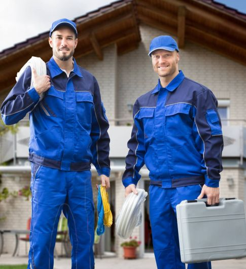 Portrait,Of,Smiling,Two,Young,Male,Electrician,Standing,In,Front